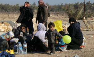 Syrians who were evacuated from the last rebel-held pockets of Syria's northern city of Aleppo