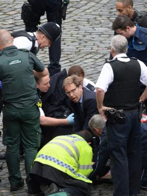 MP Tobias Ellwood helps at the scene of the stabbing of the police officer