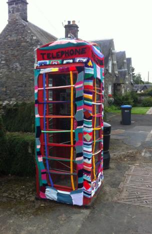 Yarn bombed telephone box