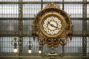 A golden clock in the train station
