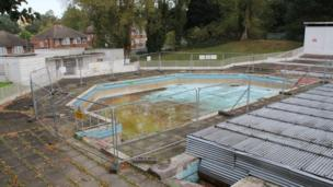 This is of the training junior pool. The metal scaffolding on the right of the image is the main pool, that has been covered with scaffolding.