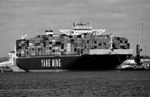 A cargo ship tightly packed and ready to go