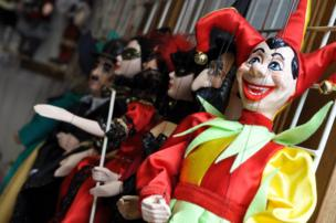 A row of puppets