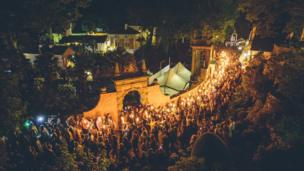 The nightly candle-lit procession through Portmeirion Village at Festival No 6.