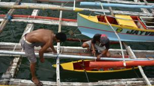 Filipino fishermen prepare and resupply their boat for another fishing trip to the Spratlys, on 10 July, 2016 in Mariveles, Bataan, Philippines.