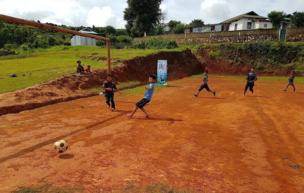 Children play football in a school in India's north-eastern state of Meghalaya