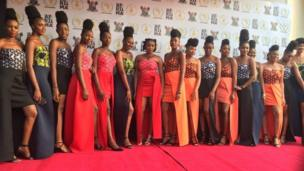 Fine lady dem wey be hostesses inside the event hall for Eko Hotel