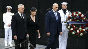 US Defence Secretary James Mattis (2-L), General John Kelly (2-R), White House Chief of Staff and Cindy McCain (C), wife of late Senator John McCain, arrive to lay a ceremonial wreath honouring all whose lives were lost during the Vietnam War at the Vietnam Veterans Memorial in Washington D.C