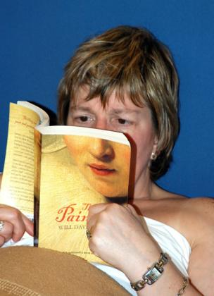 A woman reads her book