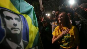 Supporters of Jair Bolsonaro, far-right lawmaker and presidential candidate of the Social Liberal Party (PSL), react after Bolsonaro wins the presidential race, in Sao Paulo, Brazil