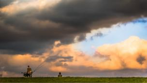 Fishermen use up the last of the evening light at Farmoor Reservoir