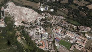 Aerial photo shows damaged buildings in old centre of Amatrice (left) after an earthquake, 24 Aug 16