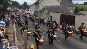 Orangemen and band members march in Loughgall, in County Armagh.