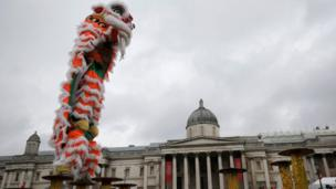 Participants perform the Dance of the Lion as they take part in an event to celebrate the Chinese Lunar New Year of the Rooster