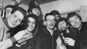 20th January 1966: The disc jockeys of seagoing pirate radio station, Radio Caroline at Walton police station in Essex after their ship ran aground in bad weather. The DJ's, including Dave Lee Travis (in hat) and Tony Blackburn