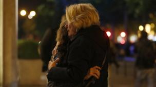 Two women hug each each other after a shooting near the Champs Elysees in Paris, France, 20 April 2017