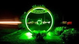 St Patrick's green belt stretched to the equator sign in Uganda