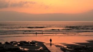 Surfers at Porthcawl's Rest Bay