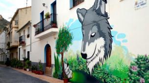 A street art mural is pictured on the facade of a house in Fanzara near Castellon de la Plana