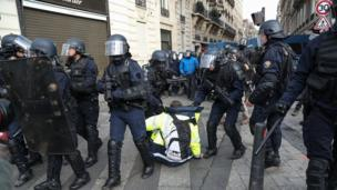Police apprehend one protester in Paris.
