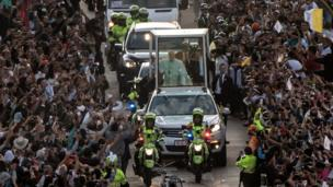Pope Francis waves from the Popemobile, upon arrival in Bogotá on 6 September 2017.