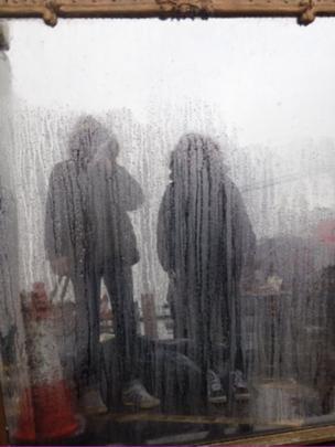 Two figures in the rain