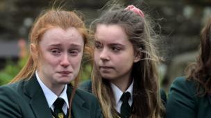 Two schoolgirls attend the funeral of Lauren Bullock