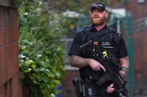 Armed police on patrol in central Manchester, 23 May