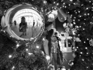 A woman is reflected in a bauble