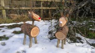 Wooden reindeer Bert and Ernie in the snow