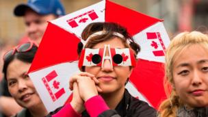 A woman wearing Canada glasses in Toronto