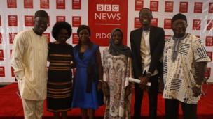 Di winner of di essay competition, Izeowayi Izaza Victor dey pose wit judges and di Head of BBC West Africa, Toyosi Ogunseye