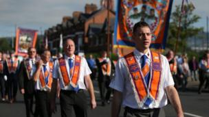 Orangemen parading along street on Twelfth of July, Belfast, 2017