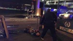 Man on ground at Borough Market