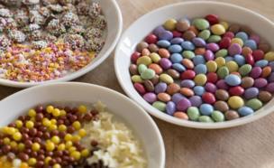 Three bowls of sweets.