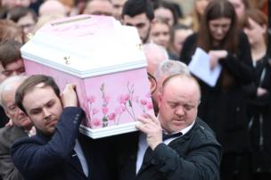 Undertakers take Lauren Bullock's coffin out of a hearse