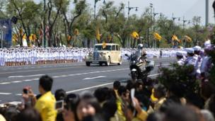 Thailand's King Maha Vajiralongkorn and Queen Suthida arrive at the Grand Palace for his coronation in Bangkok on May 4