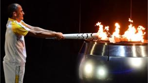 Former Brazilian athlete Vanderlei Cordeiro lights the Olympic cauldron with the Olympic torch during the opening ceremony of the Rio 2016 Olympic Games at Maracana Stadium in Rio de Janeiro on August 5, 2016