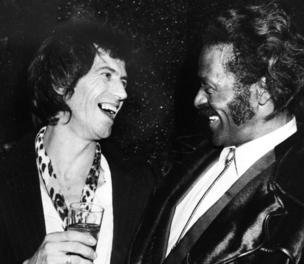 Chuck Berry, right, laughs with fellow guitarist Keith Richards of the Rolling Stones at New York's Studio 54 in February 1980.
