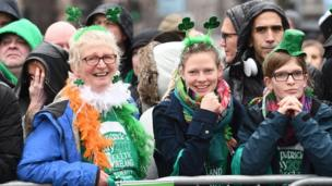 The crowds sprouted shamrocks as they waited for the Belfast parade
