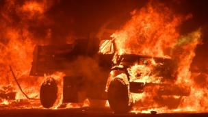 A truck burns as fire ravages the Napa wine region in California on October 9, 2017, as multiple wind-driven fires continue to whip through the region