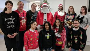 A group photo of Royal College of Speech & Language Therapists staff wearing Christmas jumpers