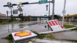 A fallen gas station sign along Biscayne Boulevard after the full effects of Hurricane Irma struck in Miami, Florida, USA