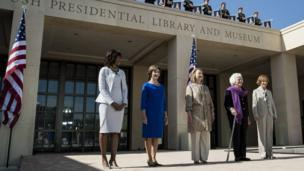 US first lady Michelle Obama, stands with former first ladies Laura Bush, Hillary Clinton, Barbara Bush and Rosalynn Carter as they arrive for a dedication ceremony at the George W. Bush Library and Museum on the grounds of Southern Methodist University April 25, 2013
