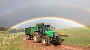 Double rainbow over tractor