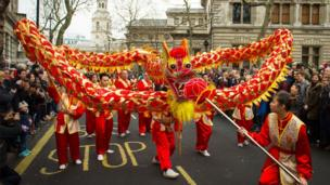 Dancers perform a traditional dragon dance during the Chinese New Year parade in London