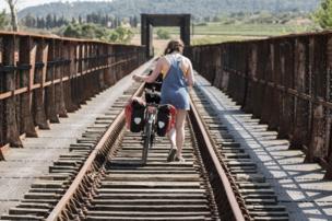 Pushing a bike across a railway bridge