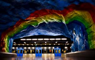 Subway station in Stockholm painted in rainbow colours