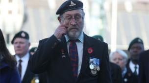 An emotional veteran at a service in Fort William