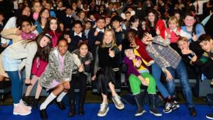 Rosamund Pike in a cinema with children